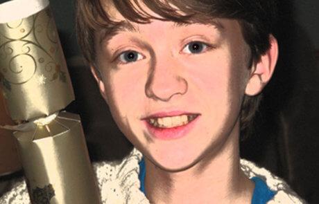 Boy-with-christmas-cracker-