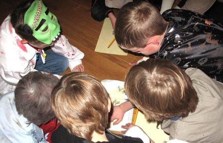Boys solving riddles