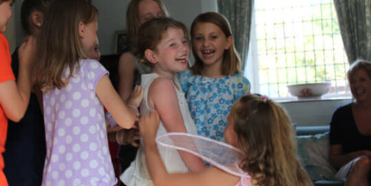Girls playing fairy party