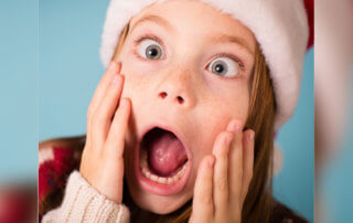 Christmas girl looking shocked
