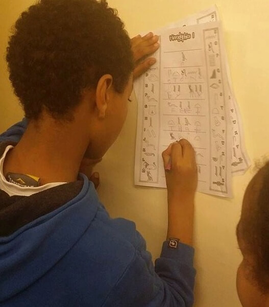 Child working out hiroglyphics